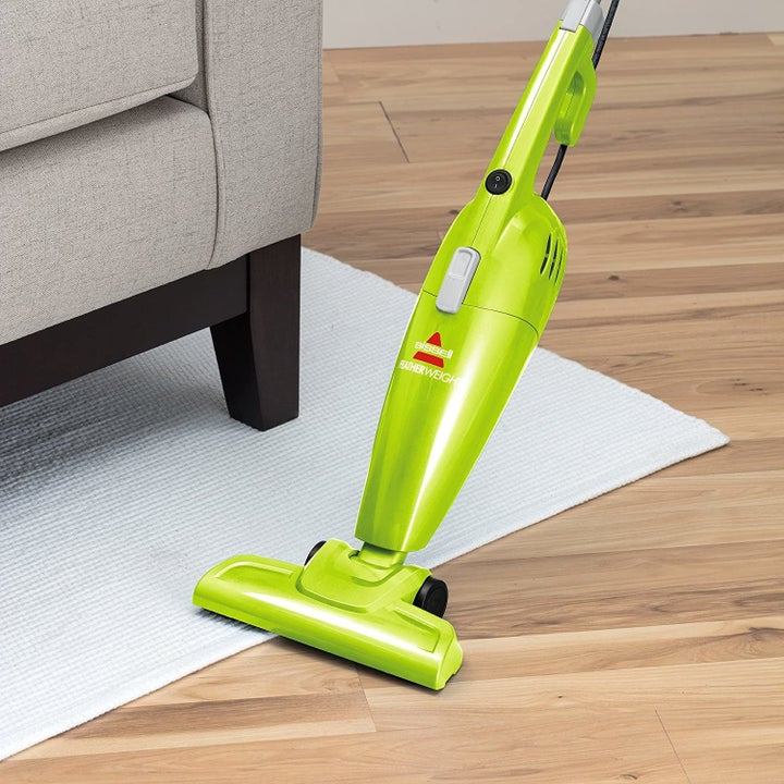 The vacuum being used to clean a hardwood floor