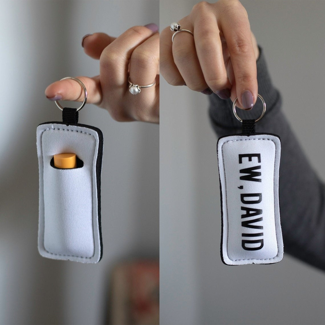 "A person holding the ""Ew, David"" lip balm pouch by the ring"