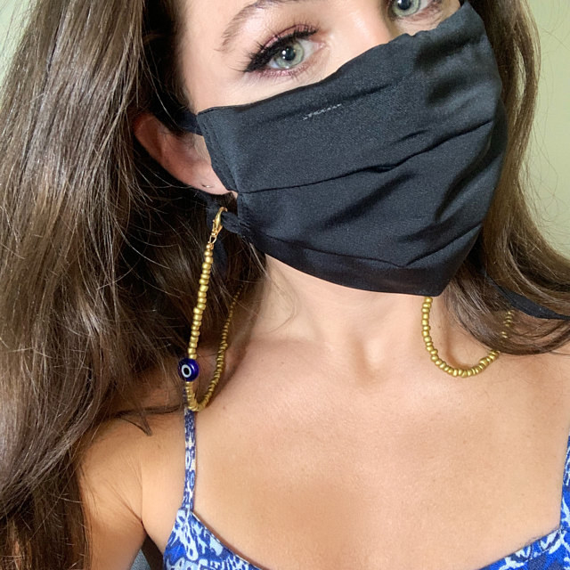 Reviewer wearing their mask with customized mask necklace chain