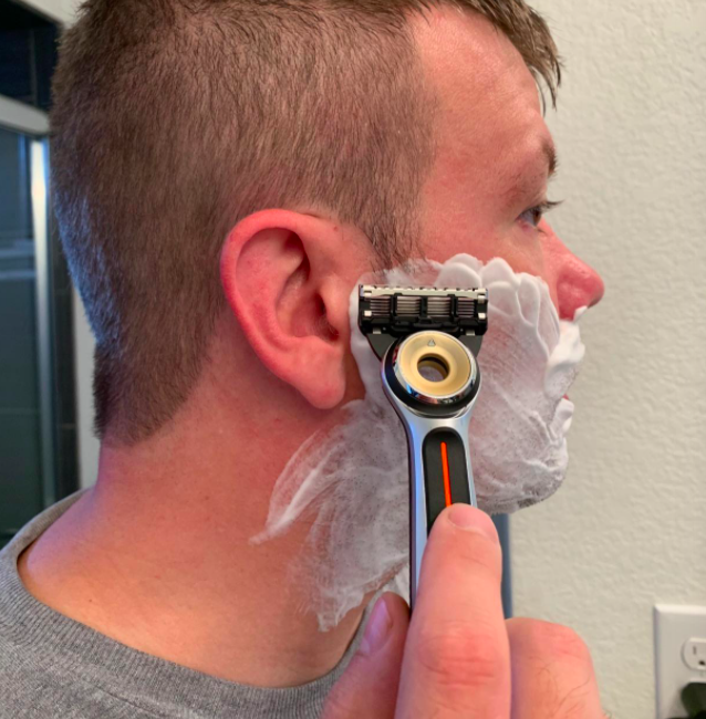 Reviewer shaving with the heated razor
