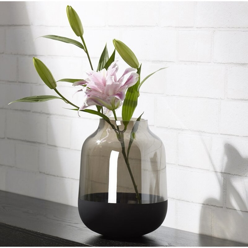 Gray and black glass table vase with flower