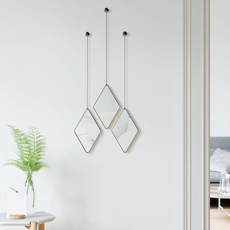 Three hanging mirrors