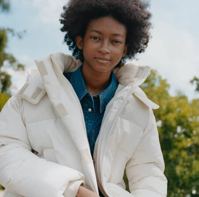 Model wearing a large white parka puffer jacket