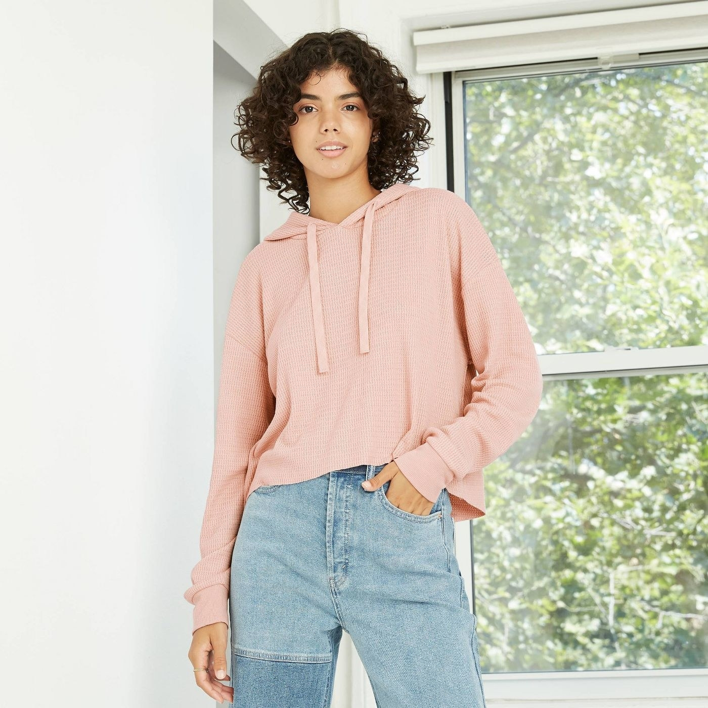 model wearing pink pullover