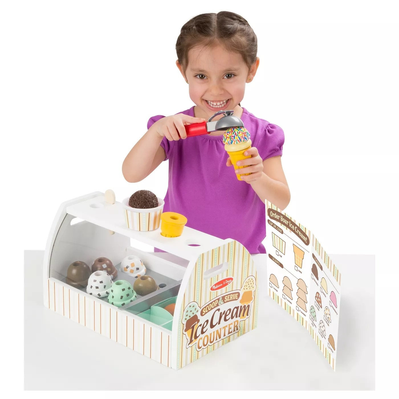 kid playing with the Ice Cream Counter Scoop & Serve toy set
