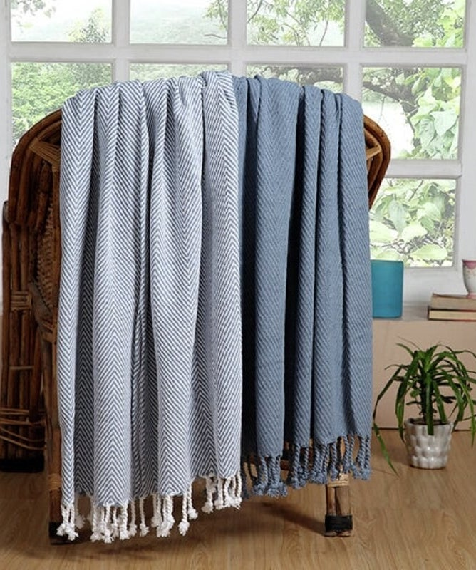 two blue cozy throw blankets over a chair