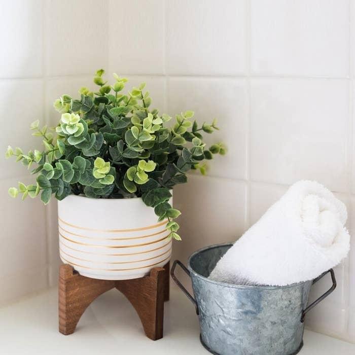 Faux eucalyptus plant in a pot