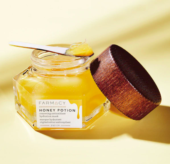An open jar of the mask to show off it's thick, honey-like texture