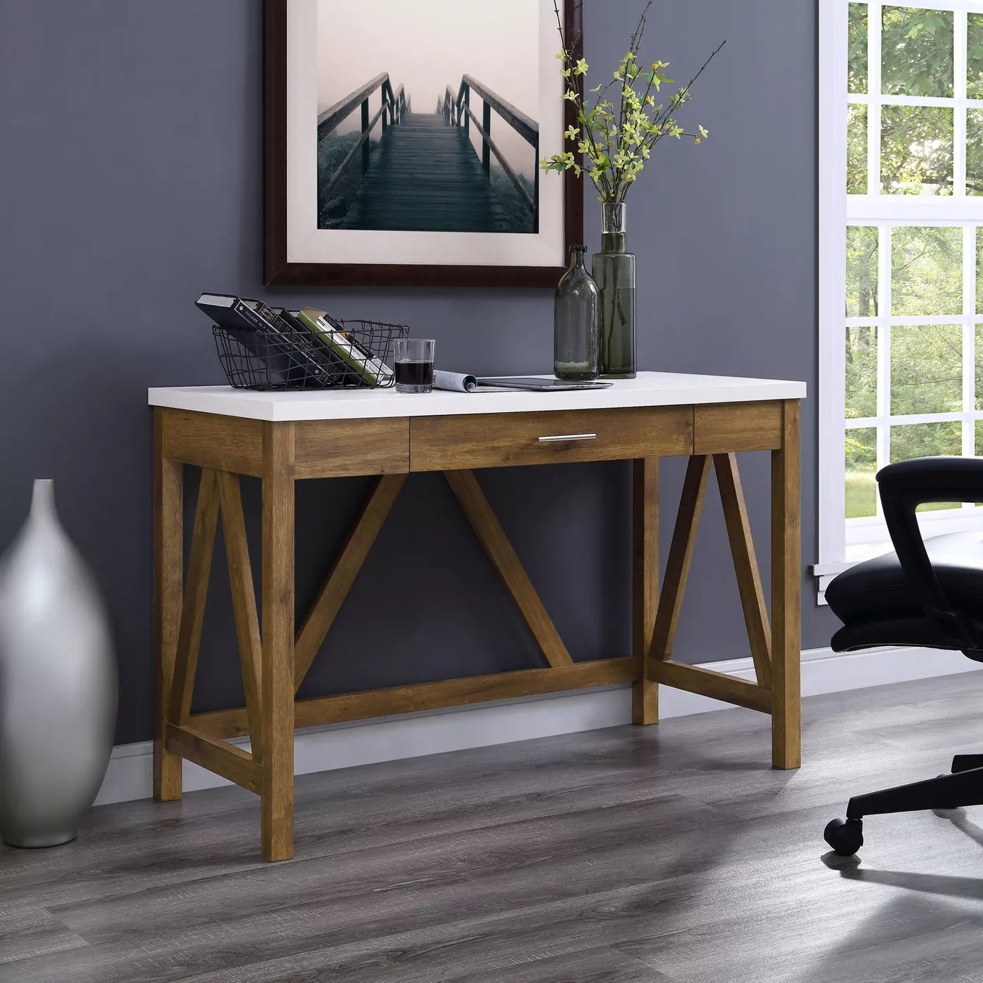 A farmhouse-style, A-frame desk with a white countertop