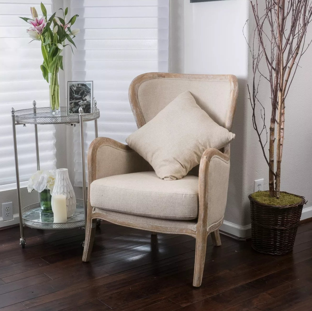 The beige, upholstered wing chair