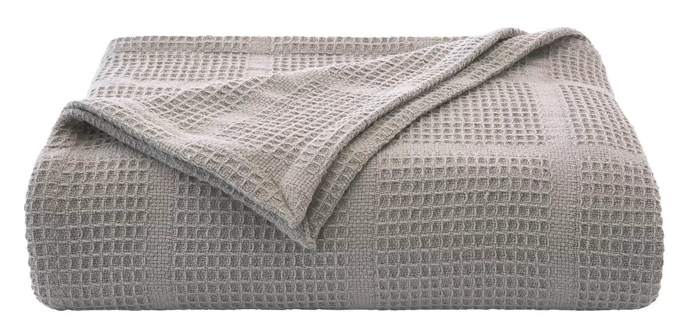 The gray waffle-knit blanket
