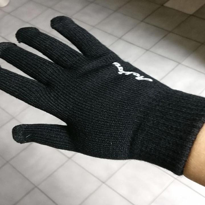 Same reviewer showing plain black of back side of glove