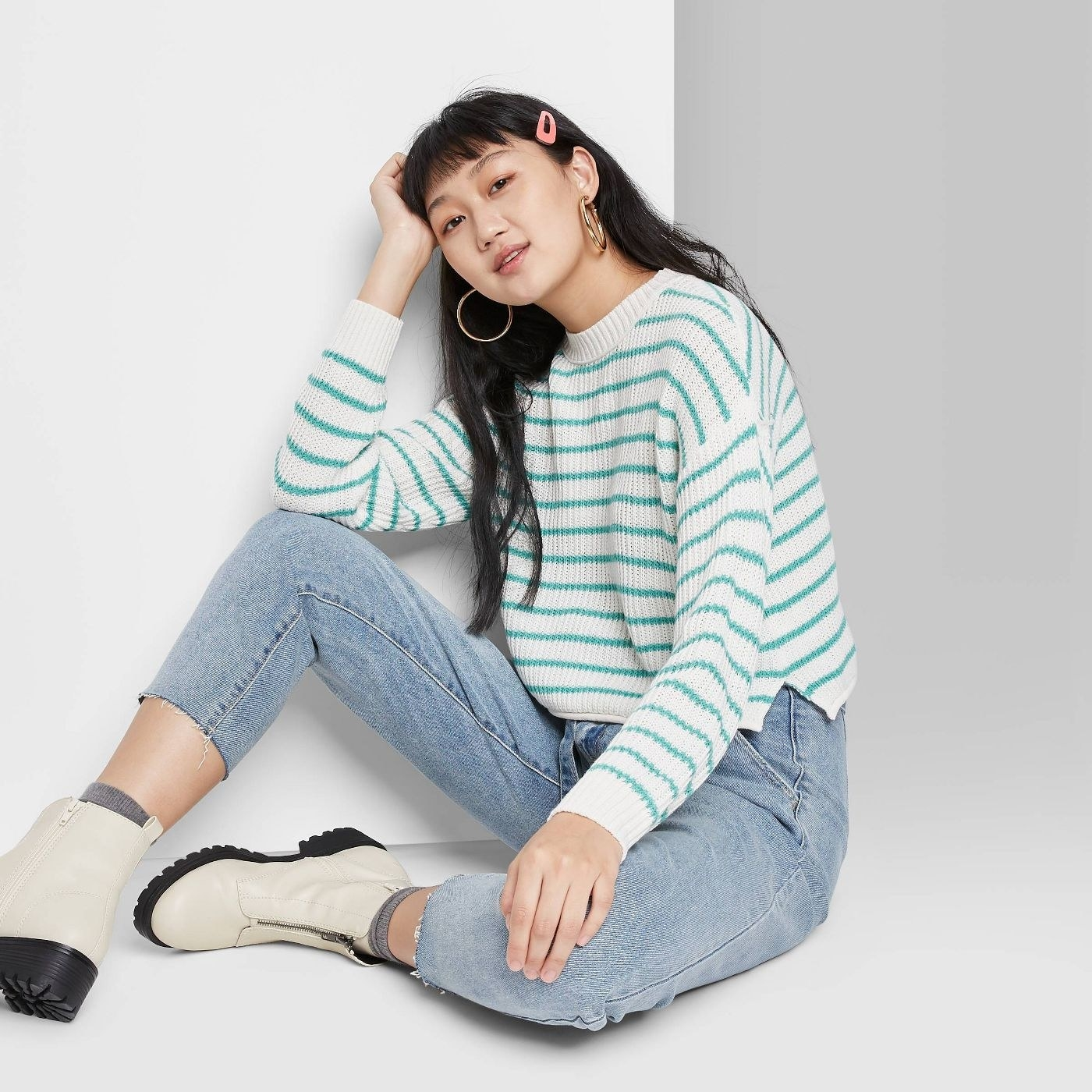 model wearing striped pullover