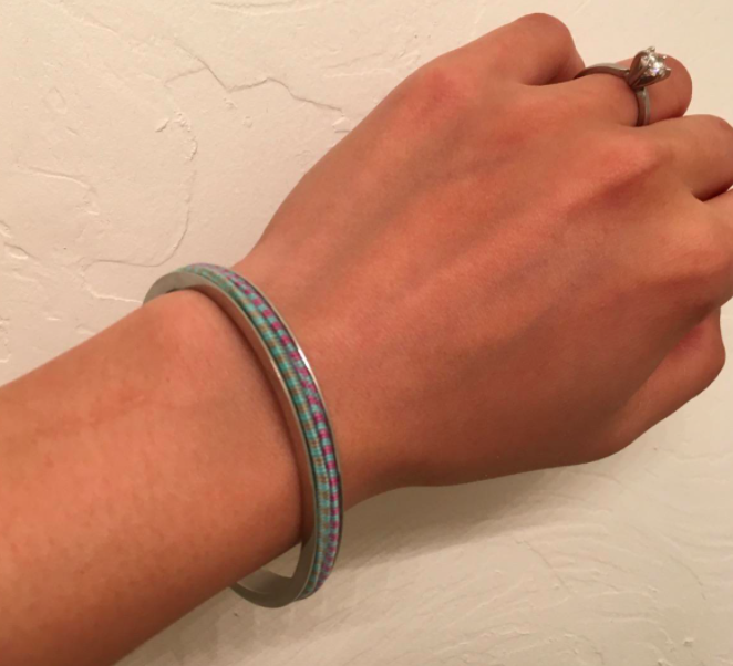 Reviewer photo showing the hair tie bracelet on a wrist with two hair ties placed around the bracelet