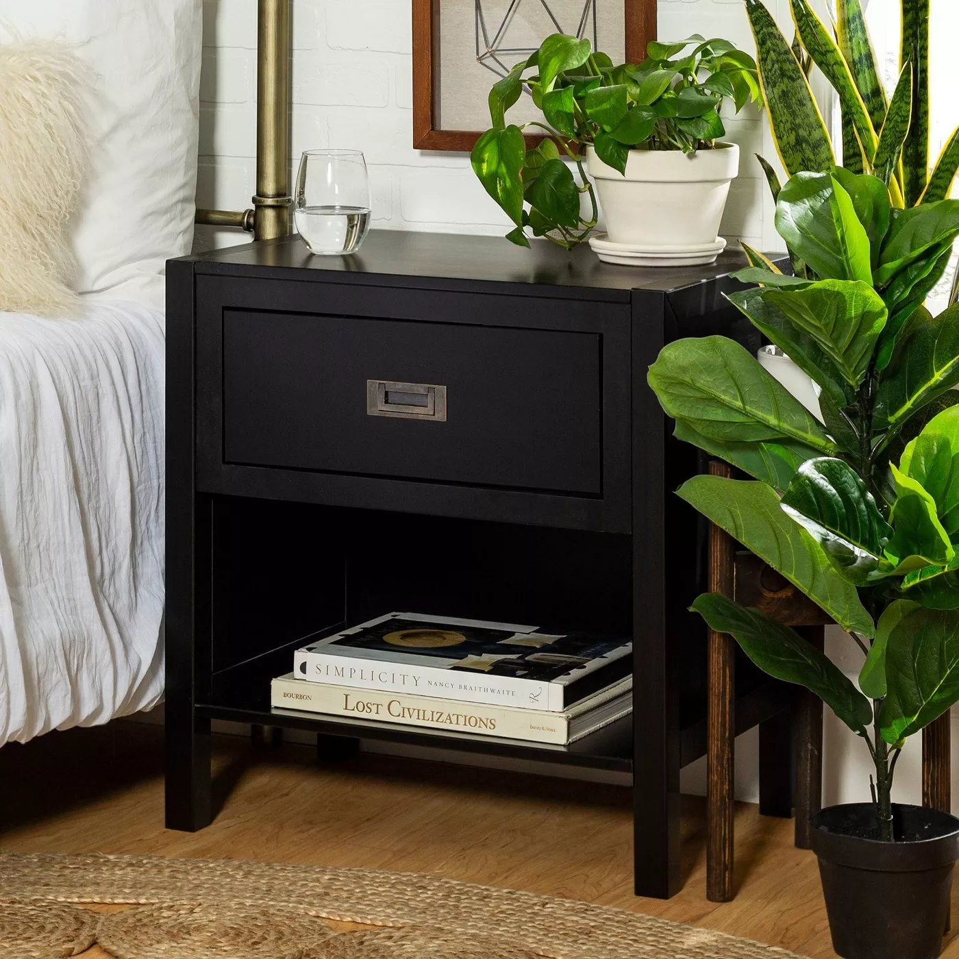 The nightstand in black with one drawer and one open shelf