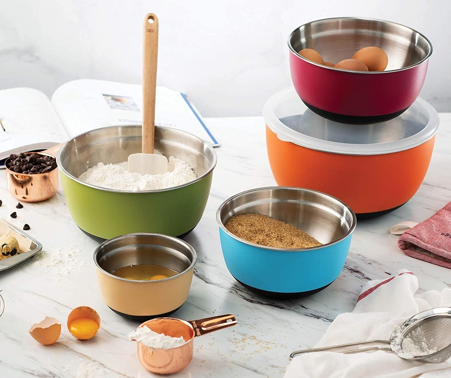 Five stainless steel bowls with different baking ingredients in them