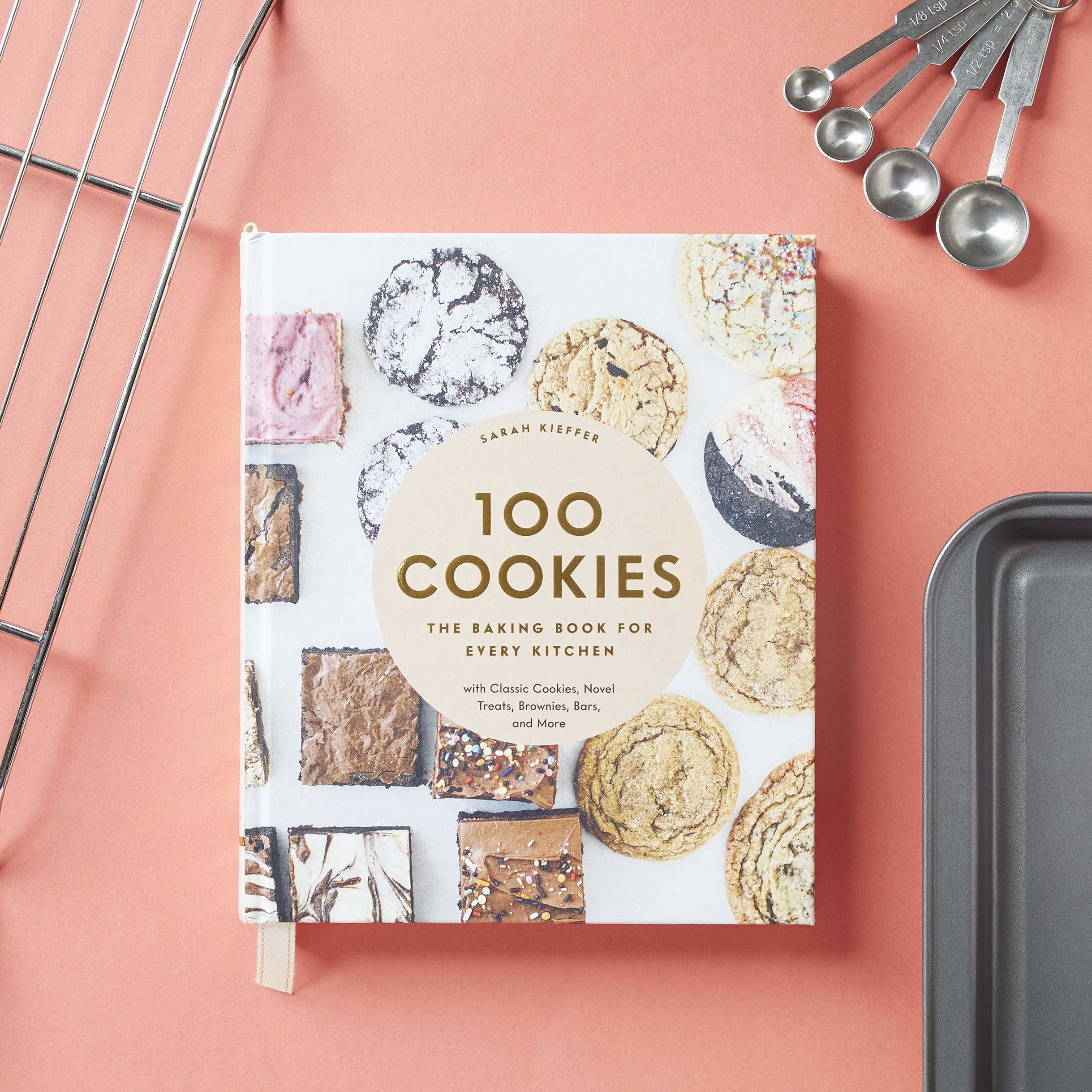 a cover of a book with a bunch of cookies on it