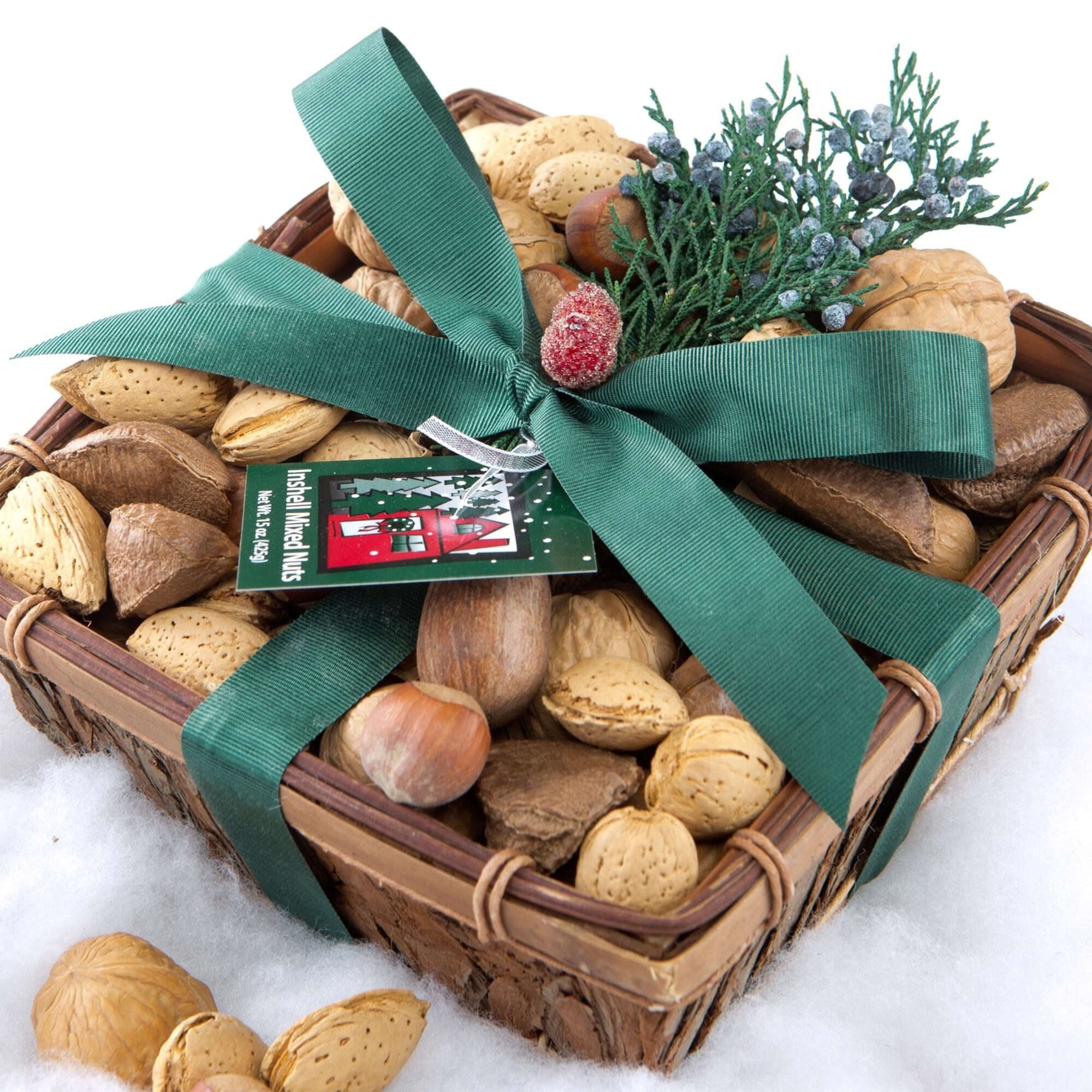 The square wood tray filled with a selection of different kinds of nuts