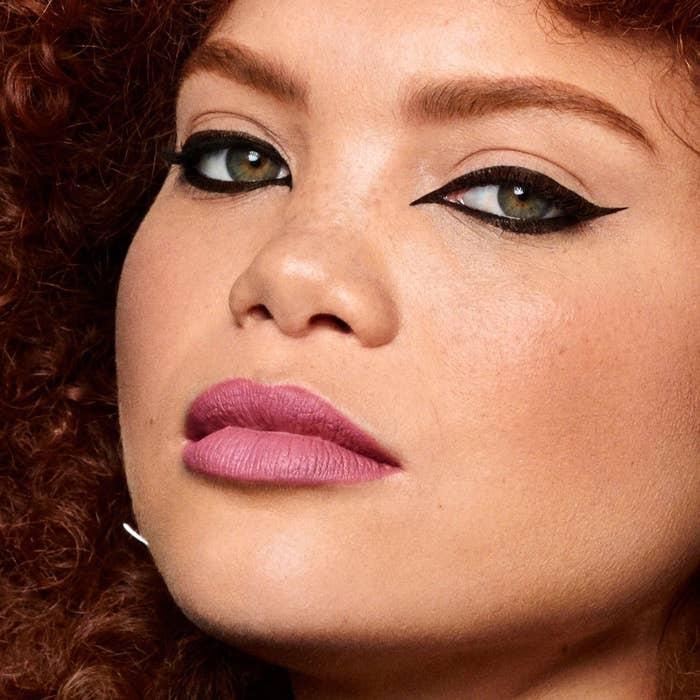 Model wears Kat Von D Tattoo Eyeliner in black