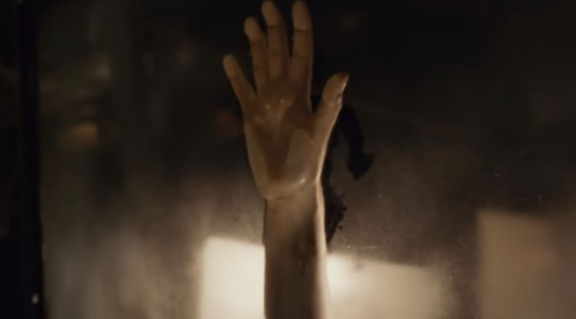 Rose's hand making an imprint against the steaming car window while she and Jack make love