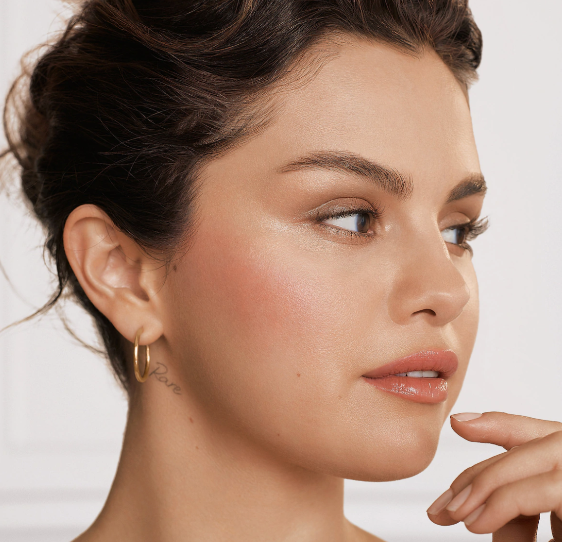 Selena Gomez wearing Positive Light Liquid Luminizer Highlight in radiant finish shade