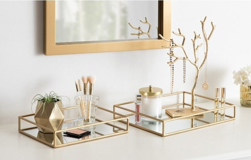 gold and mirrored vanity trays