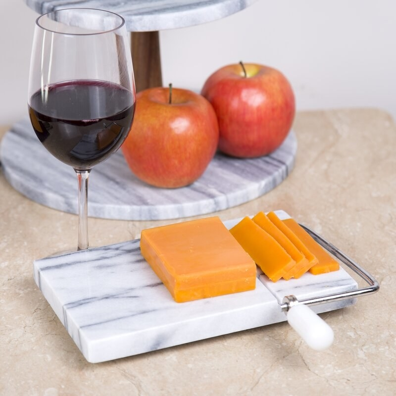 Marble cheese board with built-in slicer