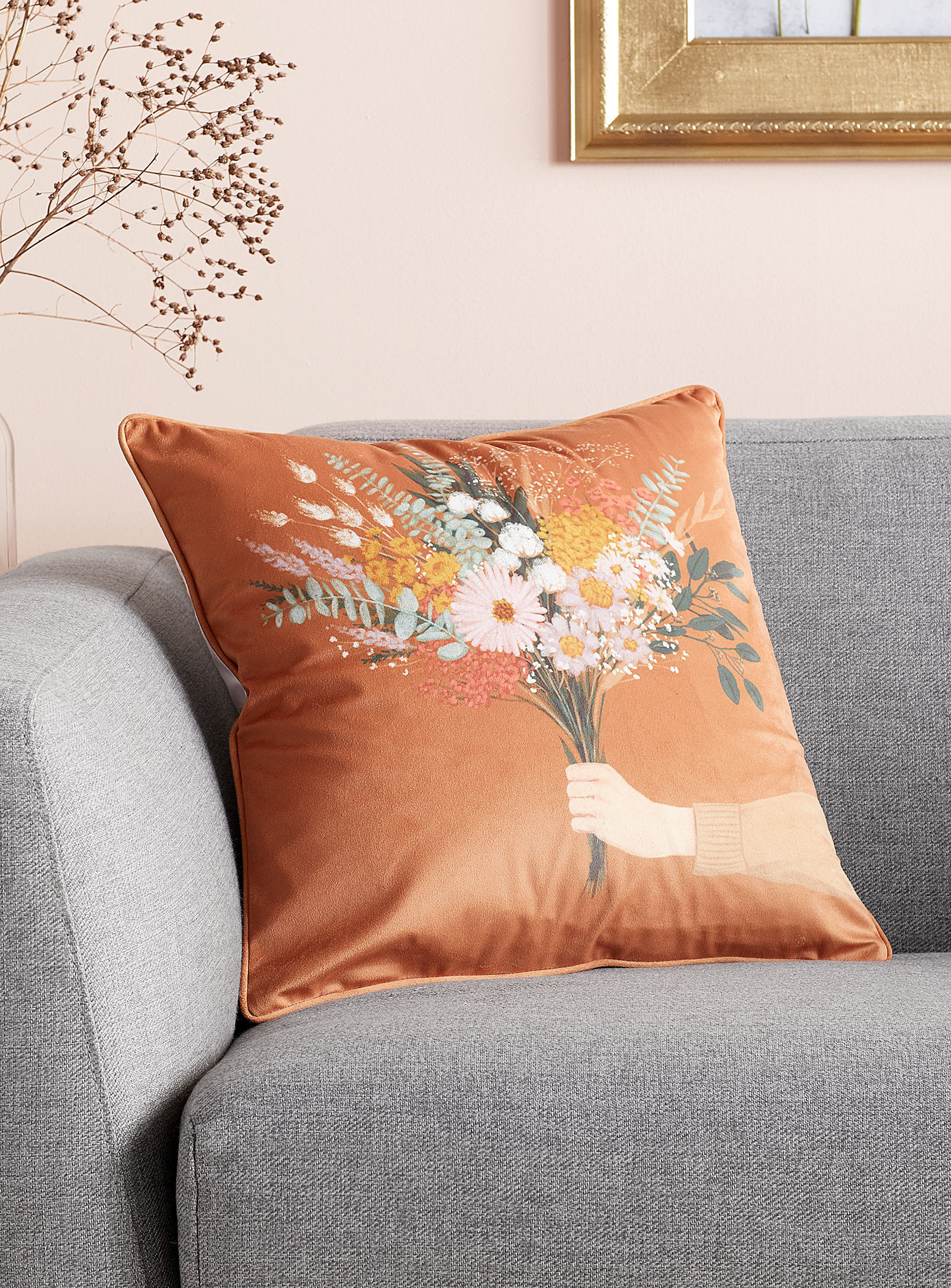 A cushion with a person holding a bouquet of flowers