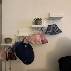 Masks, hats, and more held up by the hooks