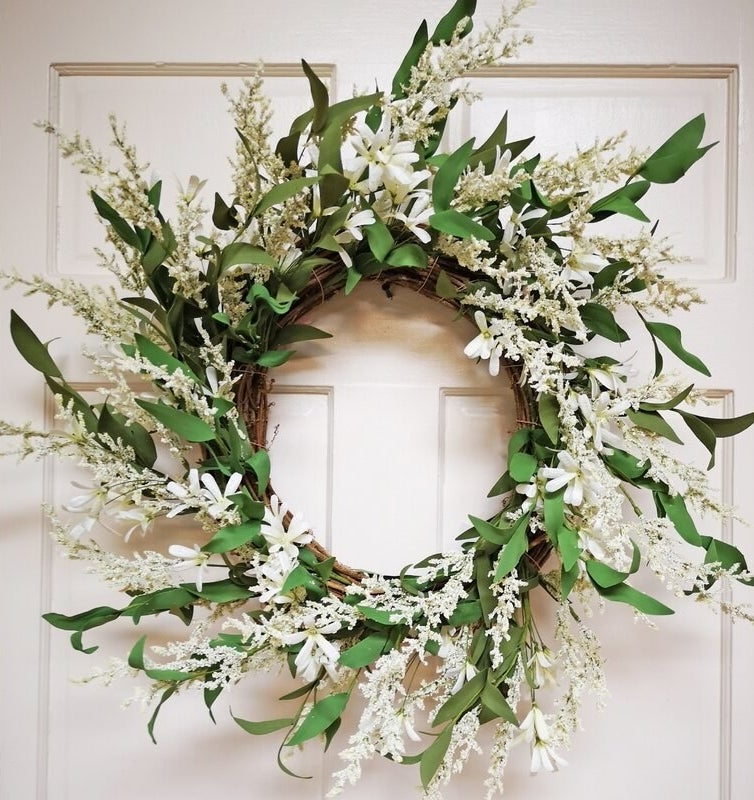 Green and white floral wreath on door