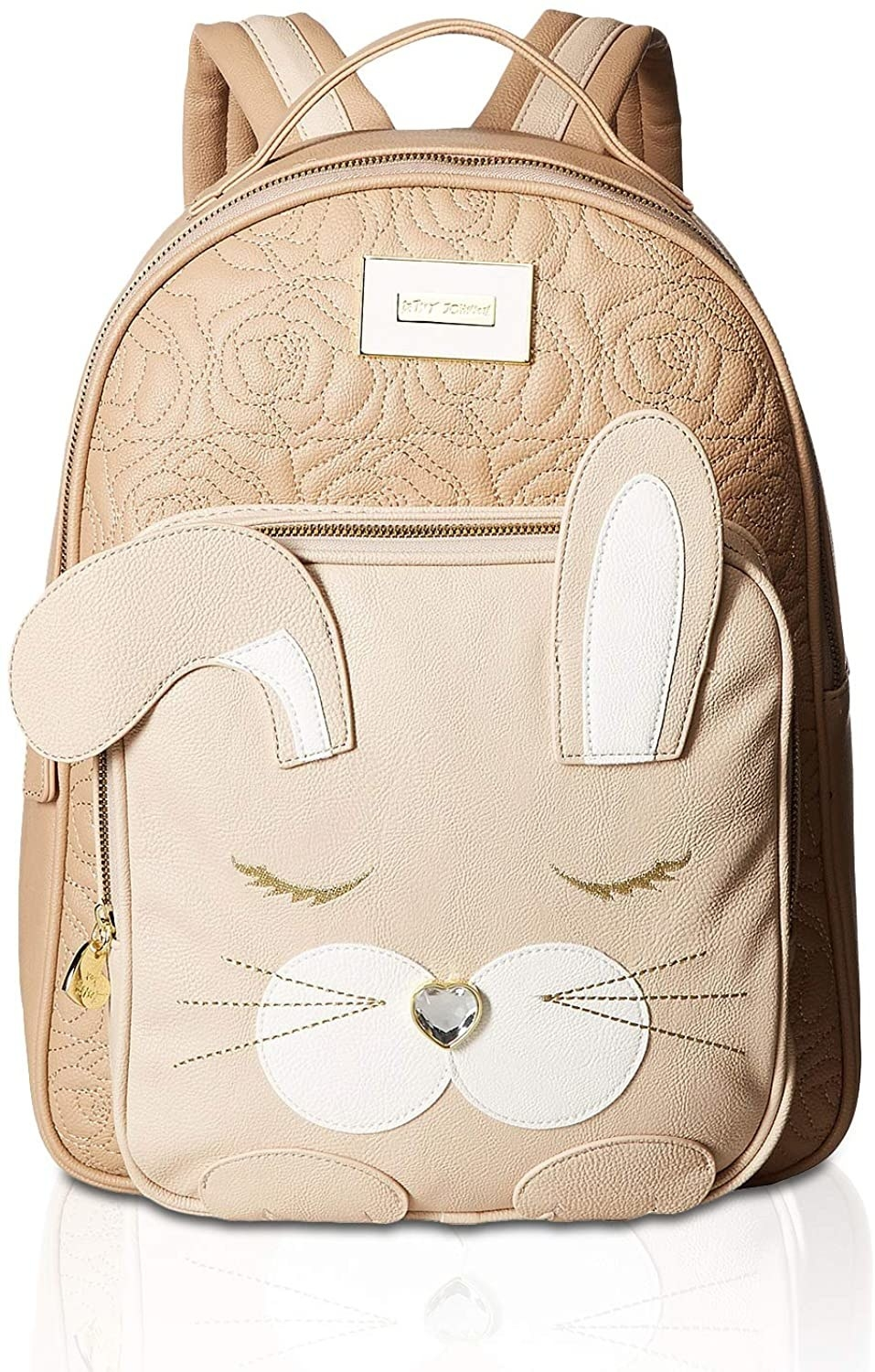 The tan quilted backpack with a front pocket with a bunny face, 3D ears, and a gemstone nose