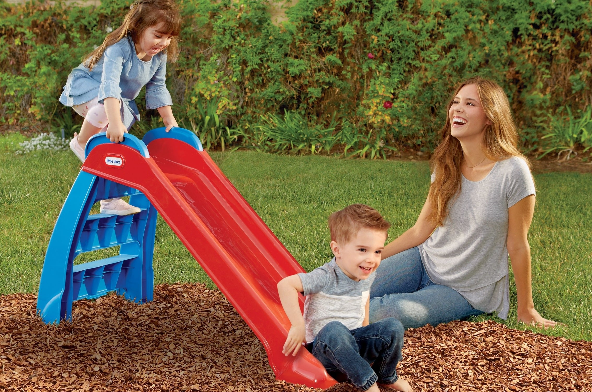 Plastic blue and red slide with easy-to-climb steps
