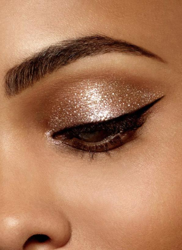 Model wears Stila Magnificent Metals Glitter & Glow Liquid Eyeshadow in Kitten Karma