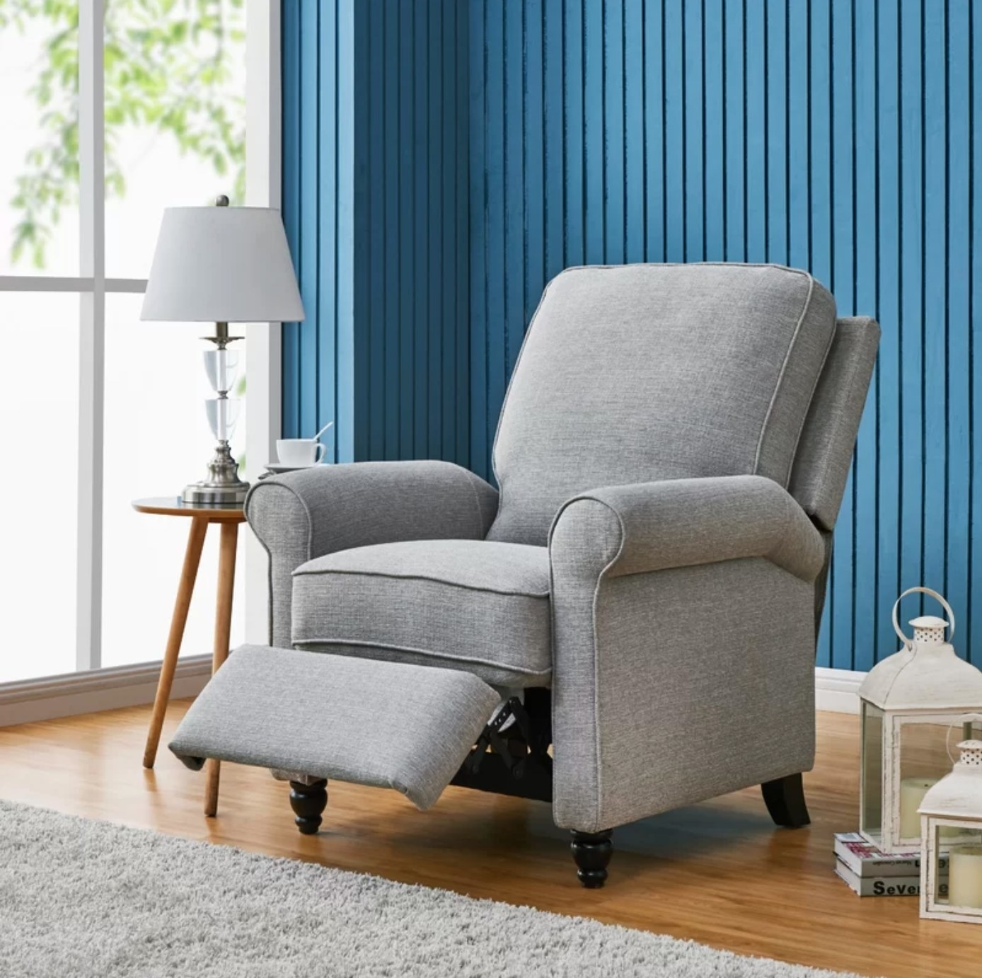 The upholstered manual recliner chair in dove gray polyester