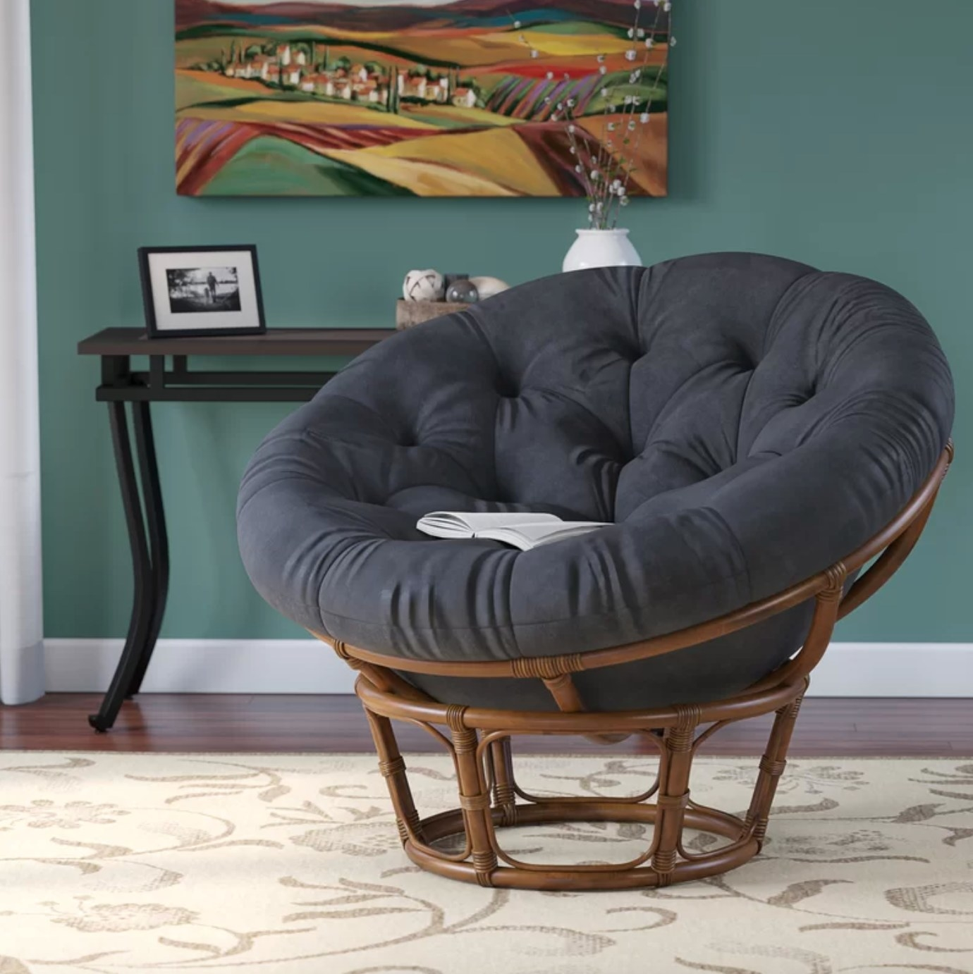 The upholstered chair with a rattan base in black microfiber