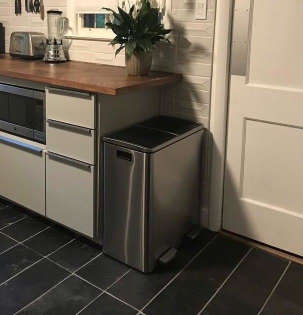 A stainless steel double trash can in the kitchen of a reviewer's home