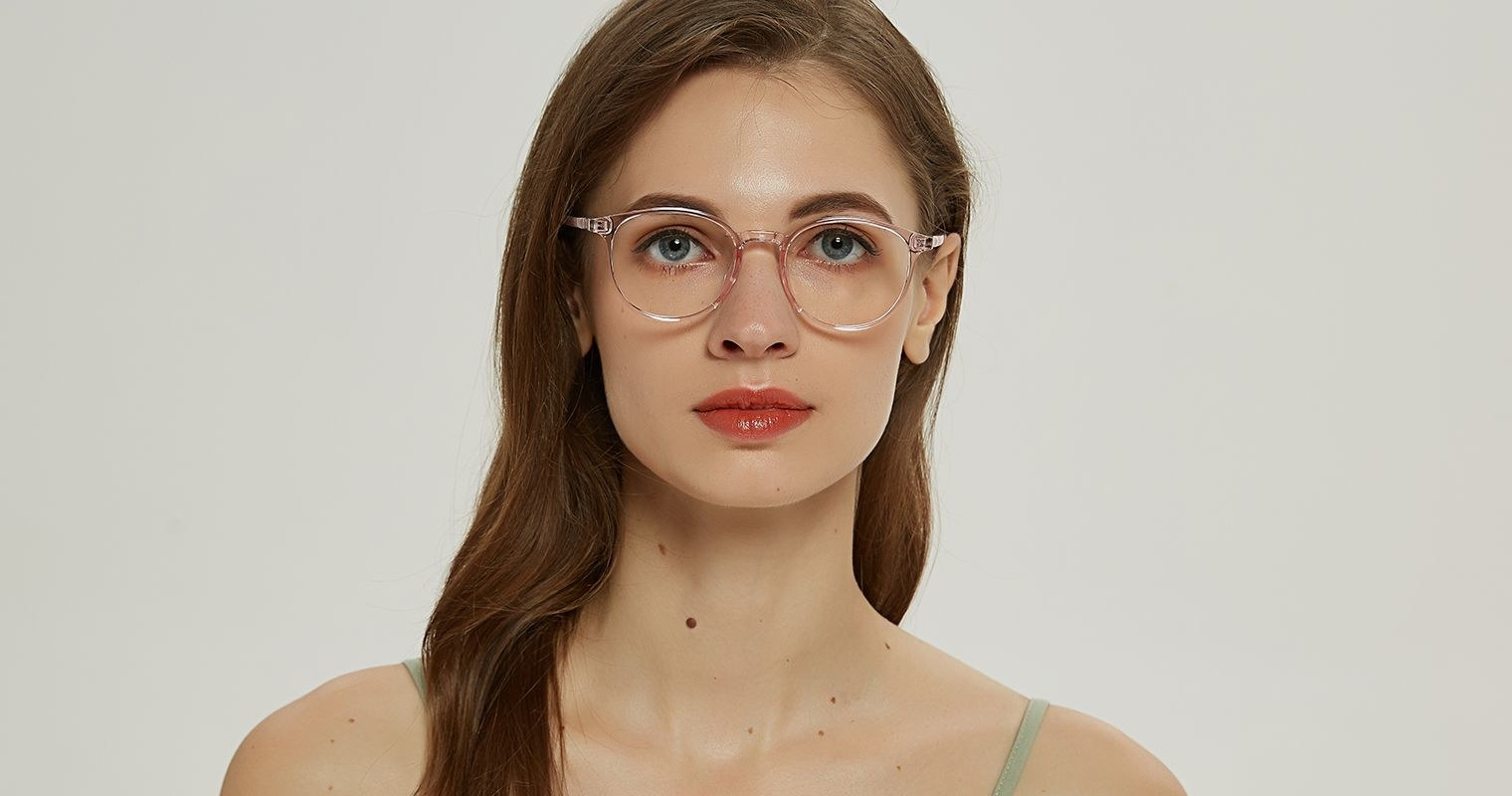 Model wearing transparent pink frames