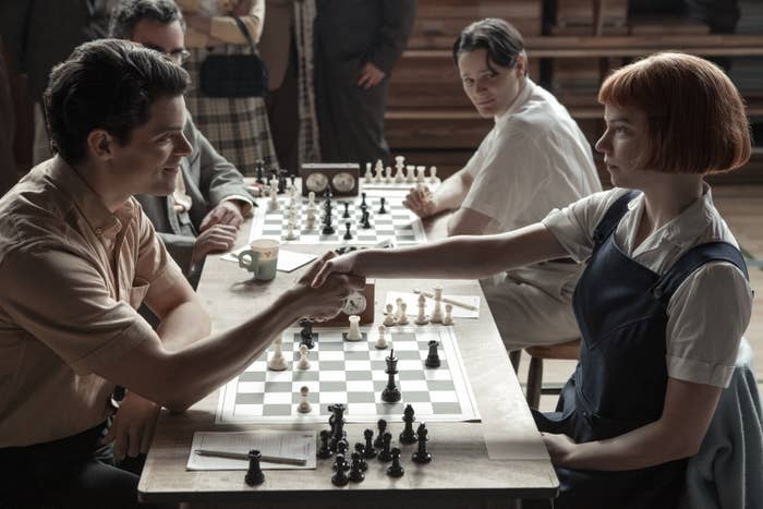 Anya Taylor-Joy as Beth shaking an opponent's hand at a chess tournament