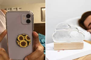 to the left: a phone with a sunflower print popsocket on it, to the right: a cloud shaped glass with crystals that indicate the weather
