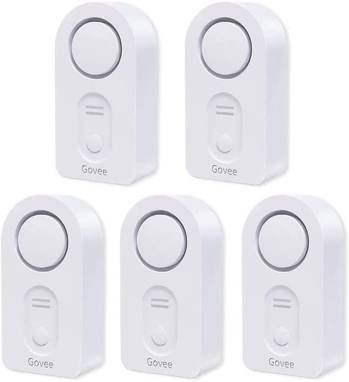 Five rounded, white sensors