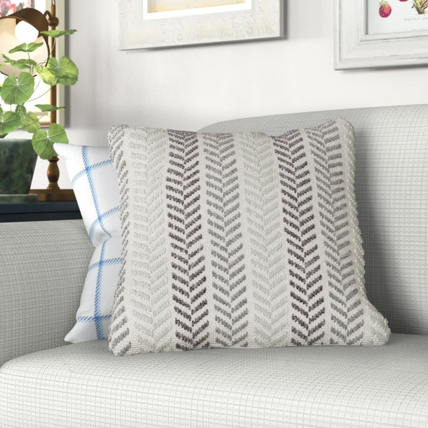 The cotton pillow cover and insert in gray