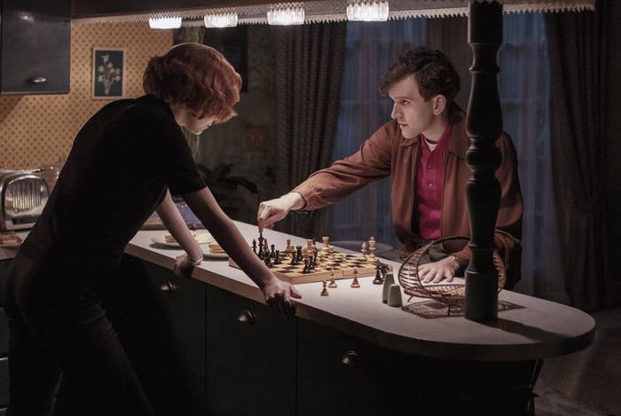 Anya and Harry playing against each other in a kitchen