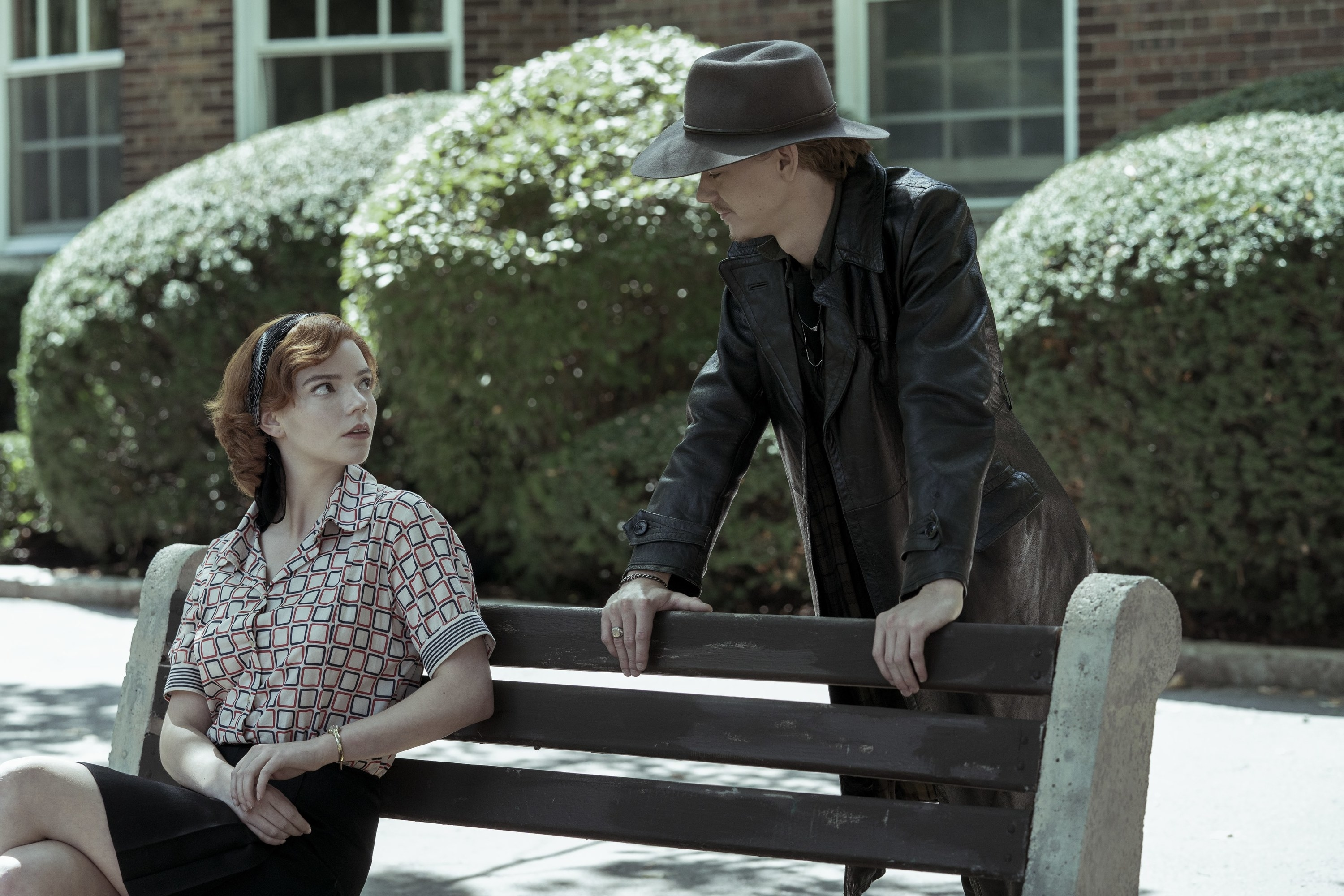 Beth sitting on a bench while Benny stands next to her