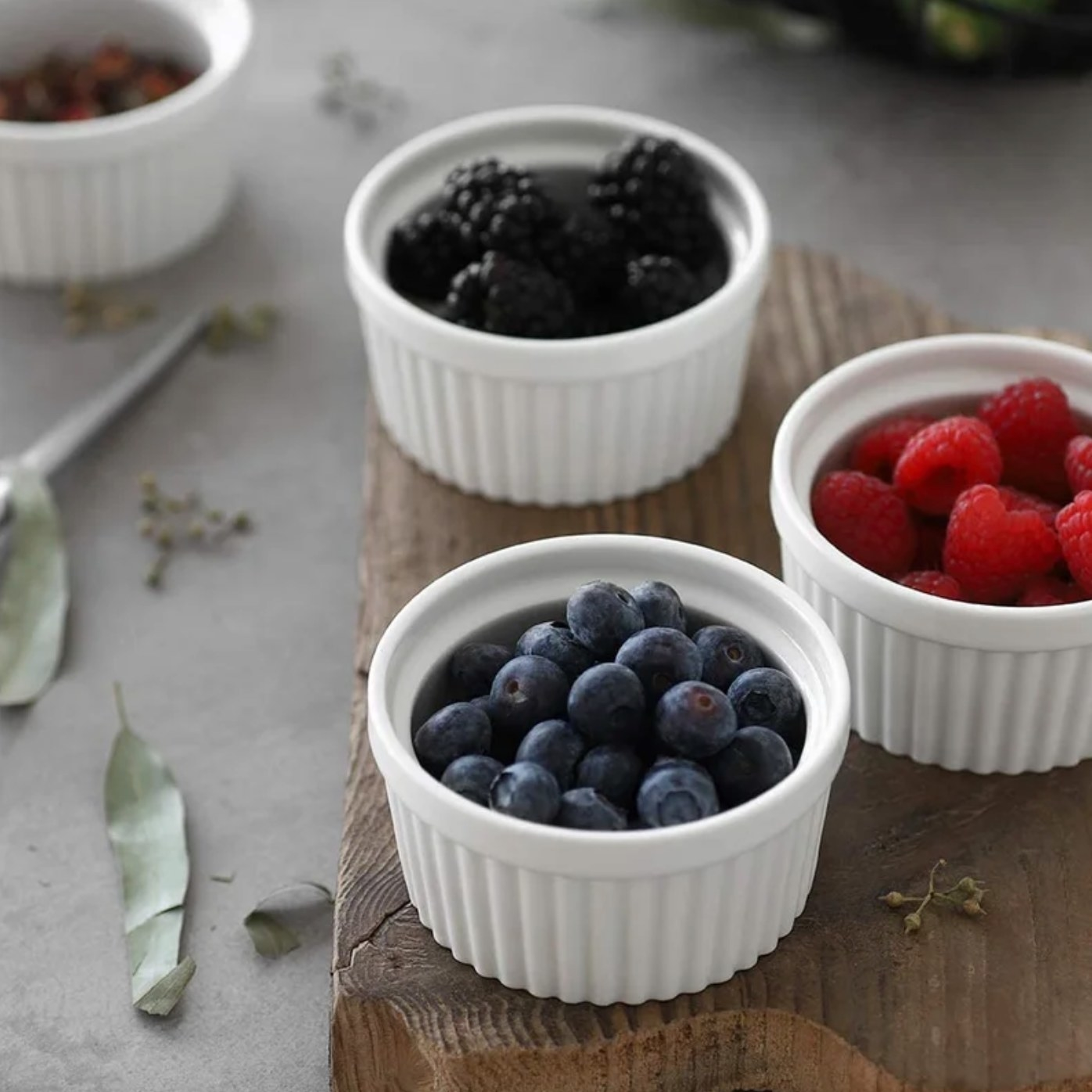 The set of six ramekins in white holding berries
