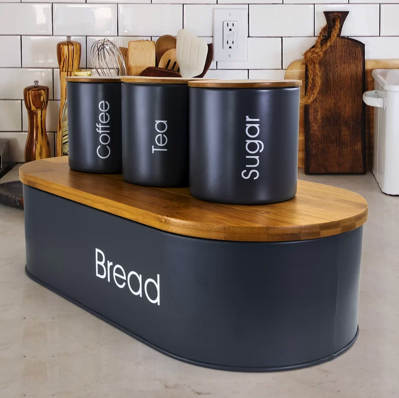 the gray set has bamboo lids and white labels that say coffee, tea, sugar, and bread