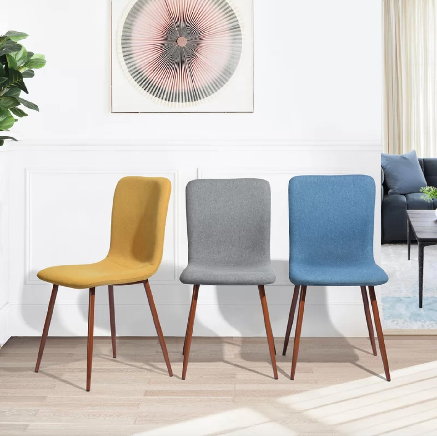 The set of four upholstered chairs in yellow