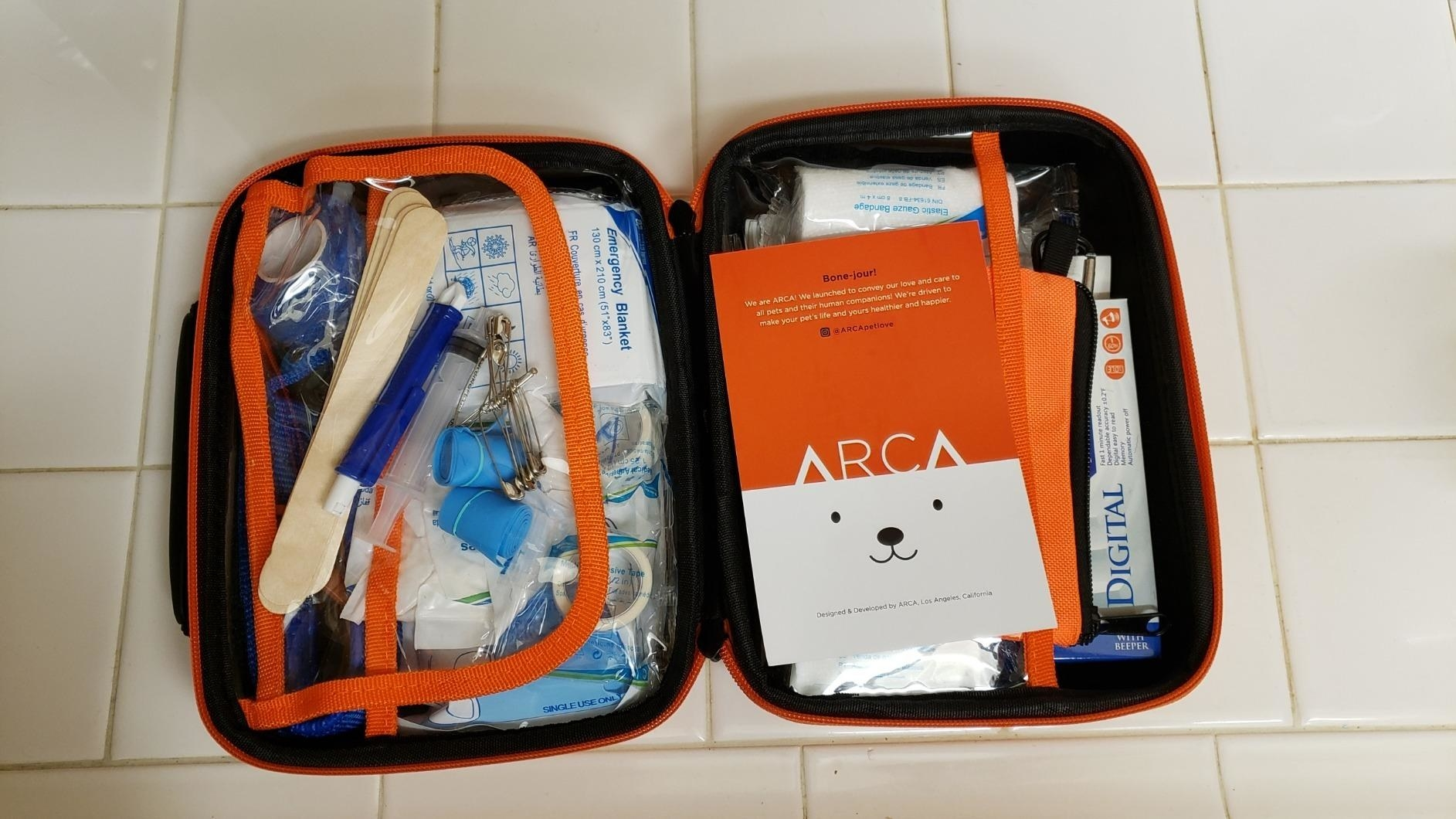 Reviewer's photo of the black and orange first aid kit