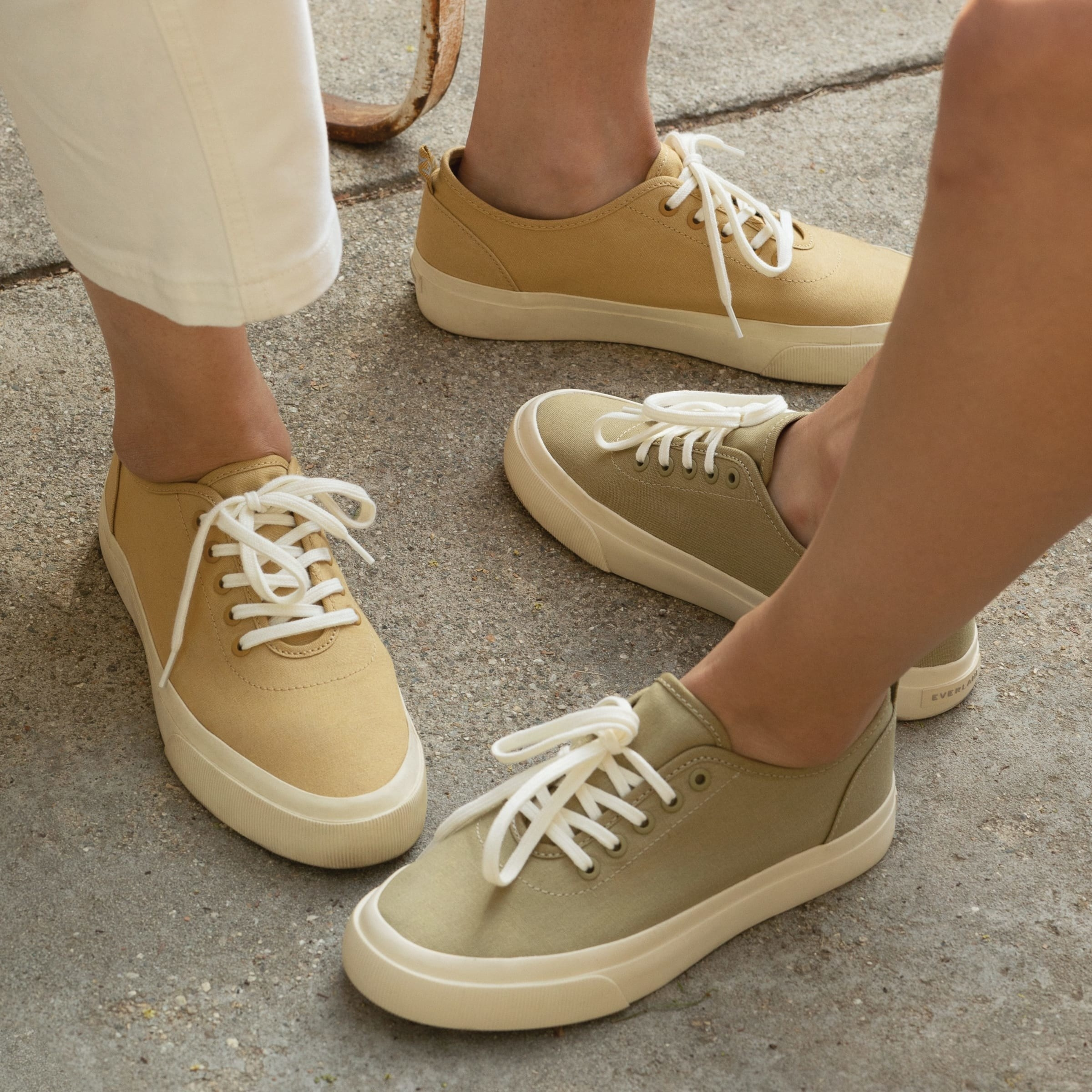 Models wearing the sneakers in teak and sycamore