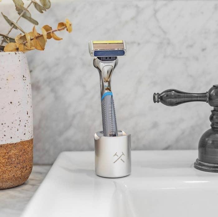 A razor on a bathroom sink