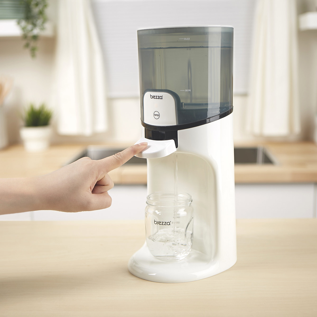 Person is dispensing warm water into a bottle